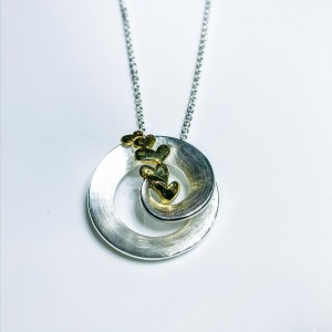 Silver pendant with gold plated hearts
